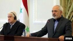 نشست خبری مشترک محمدجواد ظریف وزیر خارجه ایران (راست) با همتای سوری خود ولید المعلم - تهران ۱۷ آذر ۱۳۹۳