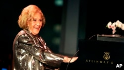 FILE - Marian McPartland playing the piano during a celebration of her 90th birthday at Jazz at Lincoln Center in New York, March 19, 2008.