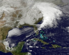 Storm clouds are seen on the east coast of the United States in this NASA handout satellite image taken at 1955 GMT, December 26, 2012.