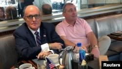 FILE - U.S. President Trump's personal lawyer Rudy Giuliani has coffee with Ukrainian-American businessman Lev Parnas at the Trump International Hotel in Washington, Sept. 20, 2019.