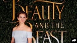 FILE - Emma Watson arrives for the Beauty And The Beast Premiere, in London, Feb. 23, 2017.