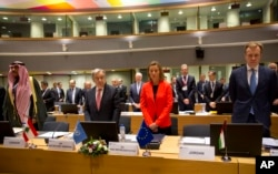 European Union High Representative Federica Mogherini, center right, and United Nations Secretary General Antonio Guterres, center left, stand for a moment of silence for the Syrian victims of war at an EU Syria conference at the Europa building in Brusse