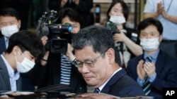 South Korean Unification Minister Kim Yeon-chul gets into a car as he leaves the government complex in Seoul, South Korea, Friday, June 19, 2020. South Korean President Moon Jae-in on Friday accepted the resignation of his point man on North Korea,…