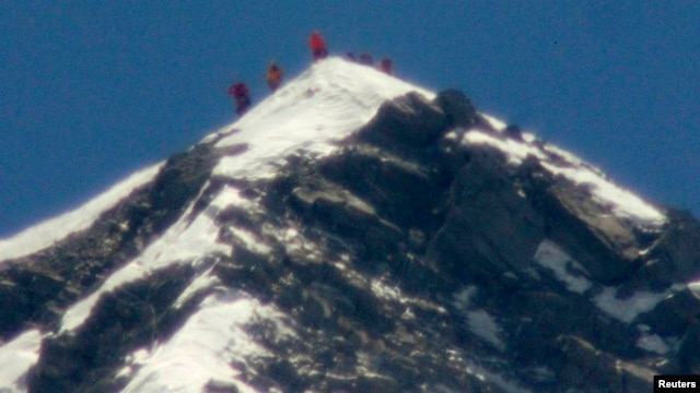 A team of climbers, including 80-year-old Japanese mountaineer Yuichiro Miura, stand on the summit of Mount Everest, in this photo taken by Kyodo, May 23, 2013.