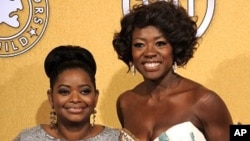 """Octavia Spencer, winner of award for outstanding performance by a female actor in a supporting role for """"The Help,"""" left, and Viola Davis, winner of the award for outstanding performance by a female actor in a leading role for """"The Help,"""" pose backstage a"""