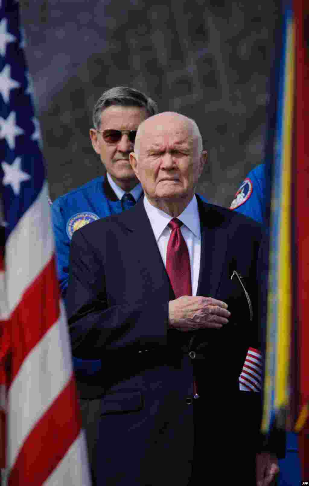 Former astronaut and US Senator John Glenn holds his hand to his heart during the playing of the National Anthem at the transfer ceremony for space shuttle Discovery. (NASA/Paul E. Alers)