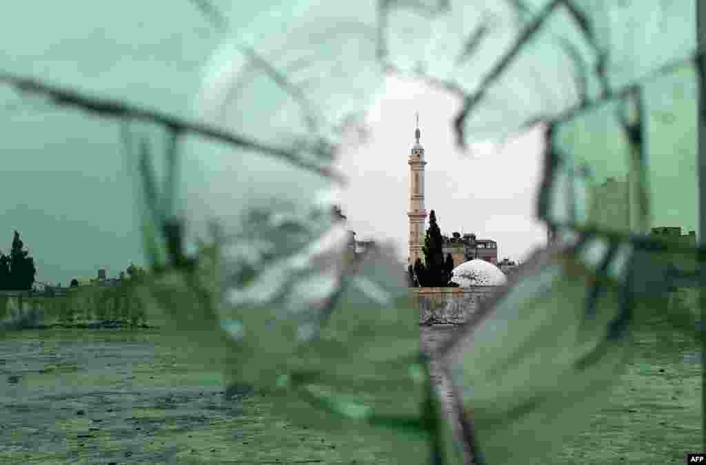 A mosque is pictured through shattered glass in the old city of Homs, Syria as rebel fighters withdrew from the city center in line with a negotiated withdrawal deal with the government after having held out under tight siege for nearly two years.