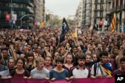Independence supporters march during a demonstration downtown Barcelona, Spain, Oct. 2, 2017.