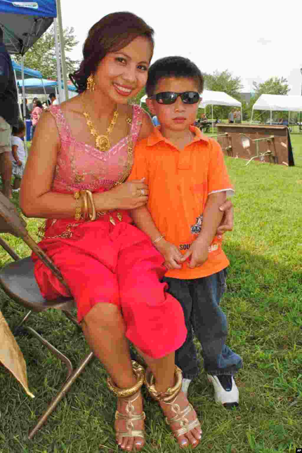Darath Ly, dressed in Cambodian wedding costume, and her four-year-old son, Aaron Ly.