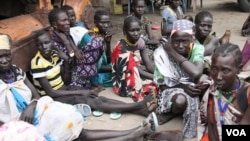 Women fear for their lives creeping back to Pibor town, but in the bush, people are starving. (Hannah McNeish/ VOA)