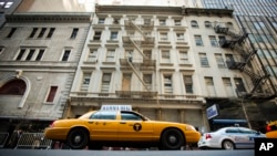 It is not always easy to get a cab in New York City. But once you get one, you may not have to say a word. Pictured here, a taxicab drives past 51 Park Place, NYC. (REUTERS/Lucas Jackson)