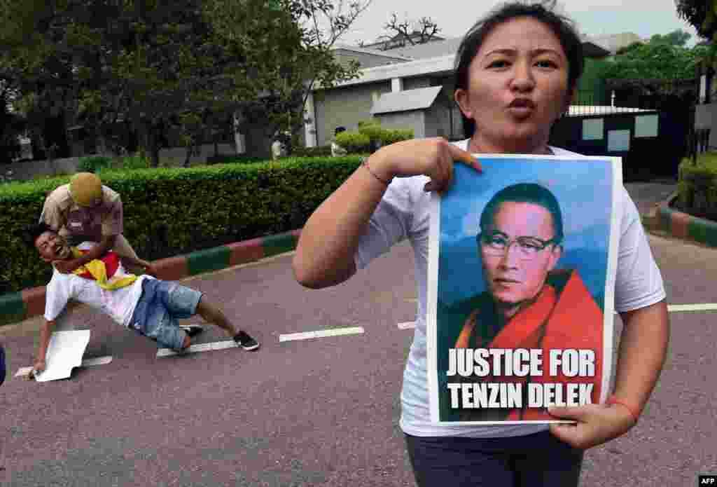 Exiled Tibetan protesters shout slogans against China during a protest outside the Chinese embassy in New Delhi, India. They were protesting over the untimely death of Tenzin Delek Rinpoche, a prominent Tibetan spiritual teacher in a Chinese prison this week.