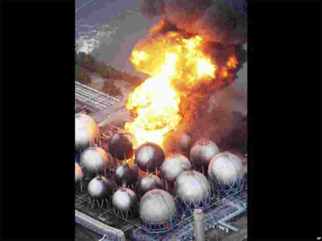 Oil refinery facility is on fire in Ichihara, Chiba Prefecture, near Tokyo, Friday, March 11, 2011, after strong earthquakes hit Japan