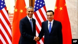 Барак Обама и Ли Кэцян