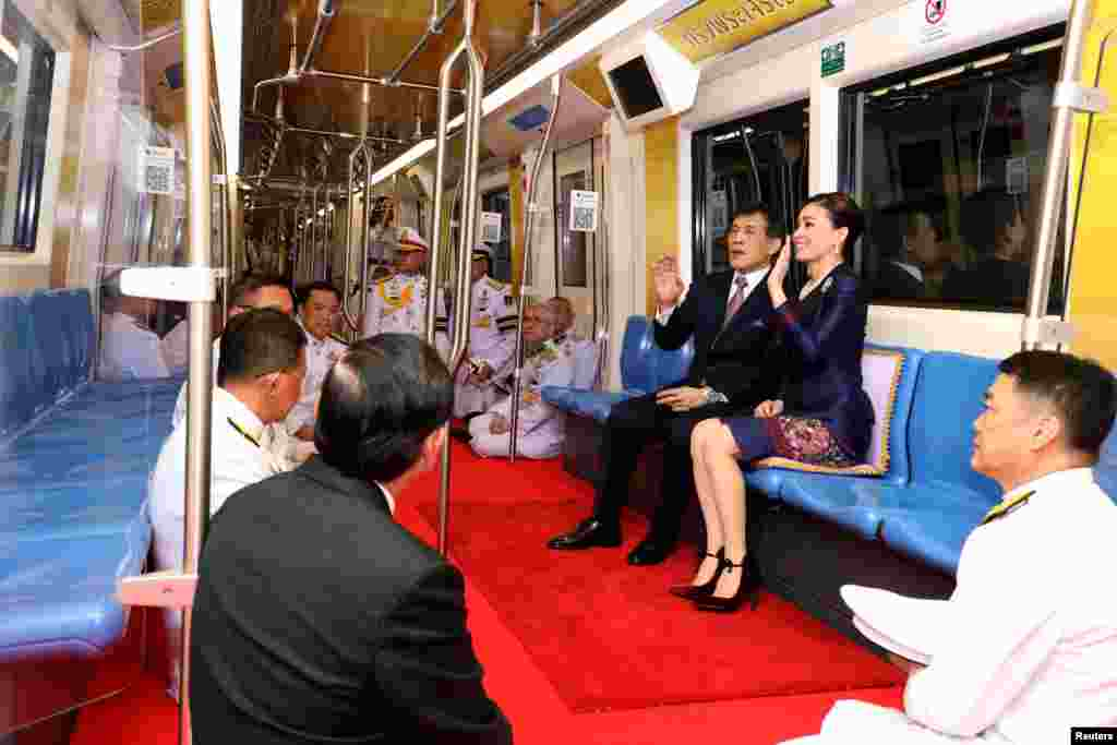 Thailand's King Maha Vajiralongkorn and Queen Suthida ride on an MRT during an inauguration of a new subway station in Bangkok.