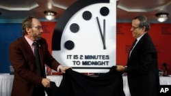 Robert Rosner, chairman of the Bulletin of the Atomic Scientists, right, and Bulletin of the Atomic Scientists member Lawrence Krauss, left, unveil the Doomsday Clock during a news conference at the National Press Club in Washington, Jan. 25, 2018.