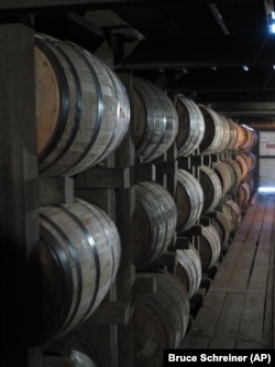 Bourbon ages in barrels at the Jim Beam distillery in Clermont, Kentucky.