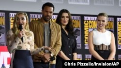 "FILE - From left, Florence Pugh, O.T. Fagbenle, Rachel Weisz and Scarlett Johansson participate during the ""Black Widow"" portion of the Marvel Studios panel on day three of Comic-Con International, July 20, 2019, in San Diego."