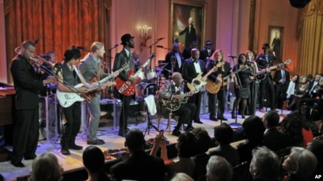 First lady Michelle Obama listen to performance during the White House …