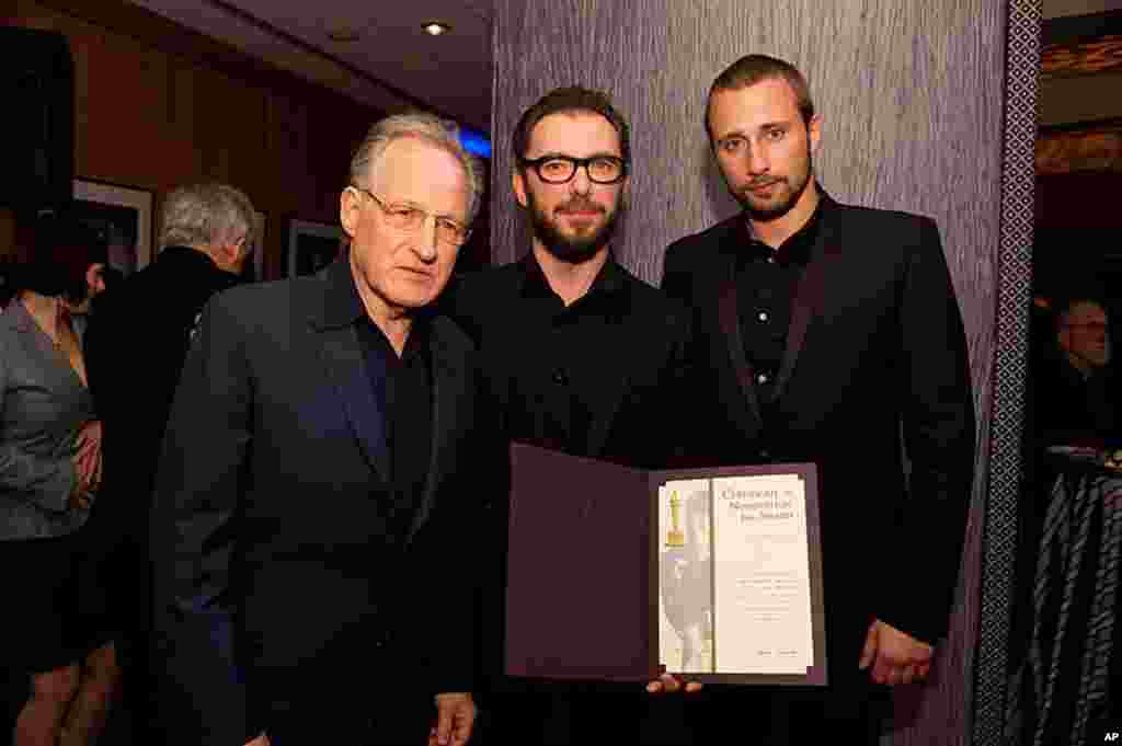 """Michael Roskam, """"Bullhead"""" (center), accepts his certificate of nomination from Oscar nominee Michael Mann (left) with actor Matthias Schoenaerts for the 84th Academy Awards from at a Foreign Language Film Award reception held in the Grand Lobby of the Sa"""