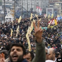 Demonstrators march with yellow BDP flags and display outlawed PKK banners during a protest against the election board's decision in Istanbul, April 19, 2011
