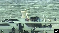 In this video image released by the Israeli Defense Ministry on November 4, 2011, Israeli soldiers on several small military boats appear to board a civilian boat believed to be one of two protest boats trying to violate Israel's blockade of the Gaza Stri