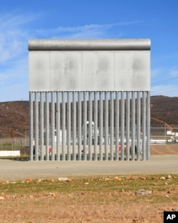 FILE - A border wall prototype stands in San Diego near the Mexico-U.S. border, seen from Tijuana, Mexico, Dec. 22, 2018.