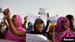 FILE - Mauritanian anti-slavery protesters march to demand the liberation of imprisoned abolitionist leader Biram Dah Abeid in Nouakchott, May 26, 2012.