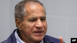 Sirhan Sirhan gestures during a Board of Parole Suitability Hearing at the Pleasant Valley State Prison in Coalinga, California, March 2, 2011, .