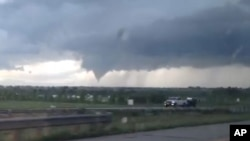 In this frame from video, a tornado moves through Longmont, Colo., Thursday, June 4, 2015.