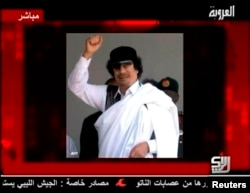 FILE: A still image of Libyan leader Muammar Gaddafi is displayed to accompany his audio message broadcast by Syrian TV channel Al-Orouba, Aug. 25, 2011. The former Libyan leader was killed in October, 2011.