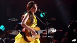 FILE - Kacey Musgraves performs onstage at The 47th Annual CMA Awards at Bridgestone Arena in Nashville, Tennessee, Nov. 6, 2013.