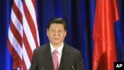 習近平在美中貿易全國委員會主辦的午餐會上發表演講。