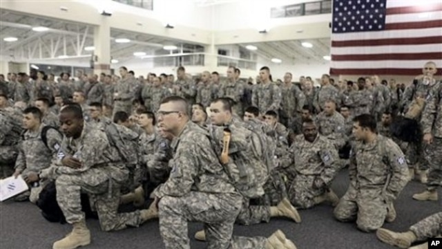 U.S. Army soldiers from 1st Brigade, 3rd Infantry Division, gather for a briefing after arriving at Hunter Army Airfield in Savannah, Ga. after an 18-hour journey home from a yearlong deployment in Iraq, (File Photo - 04 Dec 2010)