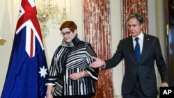Secretary of State Antony Blinken and Australian Foreign Minister Marise Payne arrive to speak with reporters at the State Department in Washington, Sept. 15, 2021.