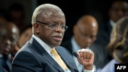 FILE - Uganda's then-prime minister, Amama Mbabazi, speaks at the World Economic Forum on Africa in Cape Town, South Africa, May 9, 2013.