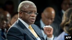 FILE - Uganda's then-Prime Minister Amama Mbabazi gives a speech at the World Economic Forum Meeting on Africa, Cape Town, S. Africa, May 9, 2013.