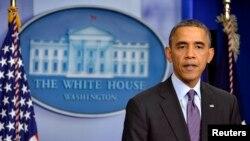Presiden Obama saat menyampaikan ucapan belasungkawanya atas wafatnya Nelson Mandela, Kamis (5/12).