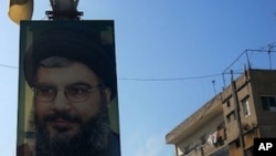 Pictures of Hezbollah leader Hassan Nasrallah decorate the streets in many parts of southern Lebanon