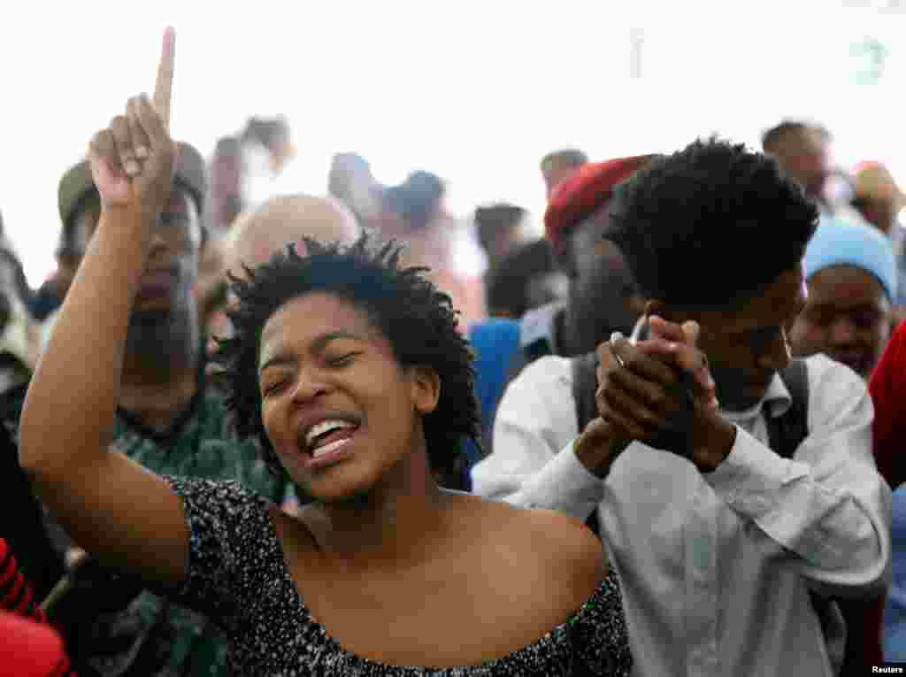 Students sing struggle songs during a gathering as academic staff and church leaders protest demanding free tertiary education at Johannesburg's University of the Witwatersrand, South Africa.