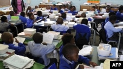 File - Pupils of Winnie Ngwekasi Primary School in Soweto study in a classroom in Johannesburg, South Africa, November 2009.