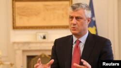 FILE - Kosovo's President Hashim Thaci gives an interview in his office in Kosovo's capital Pristina, Jan. 16, 2017.