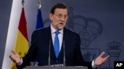 Spain's Prime Minister Mariano Rajoy speaks during a news conference at the Moncloa Palace in Madrid, Friday, Aug. 3, 2012.