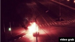 An unconfirmed video grab image of a vehicle burning in a street in Grozny, Chechnya.