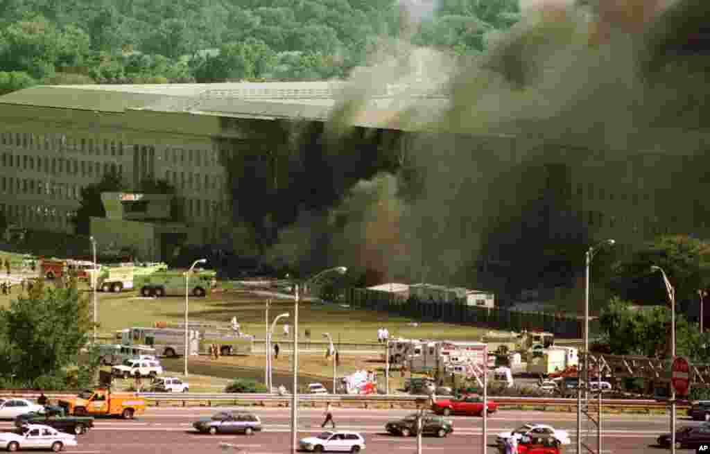 Vehicles are shown traveling on Interstate 395, leaving Washington, in front of the Pentagon, following an explosion Tuesday, Sept. 11, 2001. (AP Photo/Tom Horan)