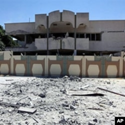 A picture taken during a government-guided tour on May 12, 2011 shows a damaged building in Bab al-Aziziya in Tripoli, following NATO air strikes on Libyan leader Moammer Gadhafi's compound