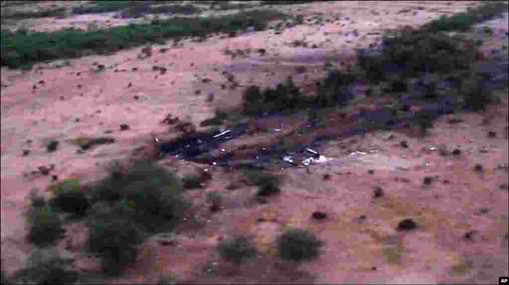 This photo provided by the French army shows the site of the Air Algerie plane crash in Mali, July 25, 2014.