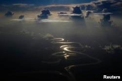 FILE - Aerial view of a river in Peru's Amazon region of Loreto, Sept. 29, 2014.
