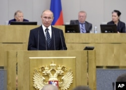 Russian President Vladimir Putin, foreground, speaks at an opening session of the newly elected State Duma, Russia's lower house of parliament, in Moscow, Russia, Oct. 5, 2016.