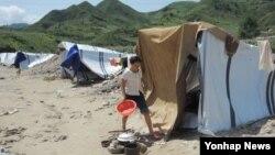 올 여름 수해가 심각한 북한 평안남도 성천군의 한 마을.